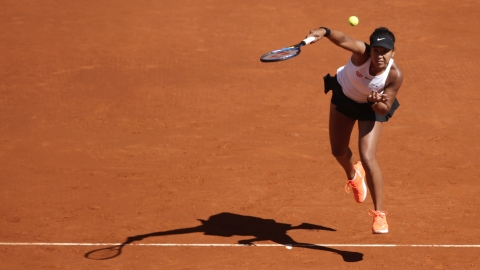 Japan's Naomi Osaka returns the ball during her match against Slovakia's Dominika Cibulkova during the Madrid Open tennis tournament, Sunday, May 5, 2019, in Madrid, Spain. (AP Photo/Andrea Comas)