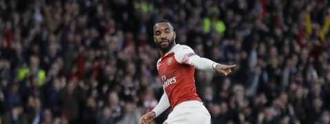 Arsenal's Alexandre Lacazette celebrates after scoring his side's first goal during the Europa League semifinal first leg soccer match between Arsenal and Valencia at the Emirates stadium on May 2, 2019.