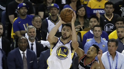 609e774cd082 Golden State Warriors  Klay Thompson (11) shoots past Portland Trail Blazers   CJ