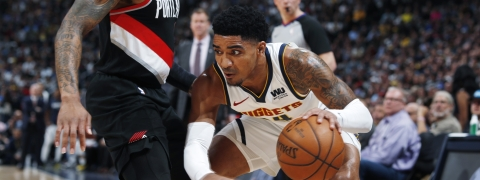 Denver Nuggets guard Gary Harris, right, is defended by Portland Trail Blazers guard Damian Lillard in Game 5 of the NBA basketball second-round playoff series on May 7, 2019.