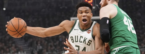 Milwaukee Bucks' Giannis Antetokounmpo drives past Boston Celtics' Aron Baynes during the first half of Game 5 of a second round NBA basketball playoff series on May 8, 2019.