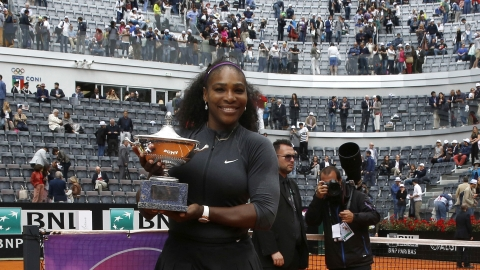 In this Sunday, May 15, 2016 file photo, Serena Williams poses with the trophy after beating Madison Keys 7-6, 6-3, in the final match of the Italian Open tennis tournament, in Rome.