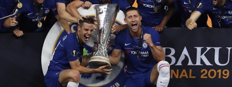 Chelsea players celebrate with the trophy after winning the Europa League Final soccer match between Chelsea and Arsenal at the Olympic stadium in Baku, Azerbaijan, Thursday, May 30, 2019. Chelsea won 4-1.