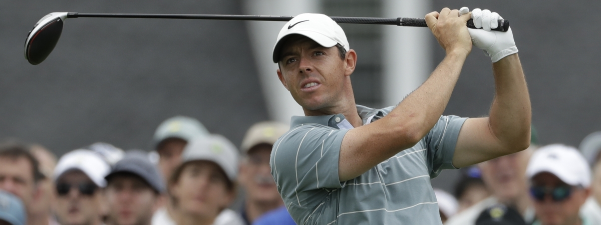 In this April 13, 2019, file photo, Rory McIlroy, of Northern Ireland, hits a drive on the first hole during the third round for the Masters golf tournament, in Augusta, Ga.