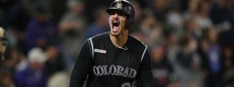 Colorado Rockies' Nolan Arenado reacts after hitting a solo home run off Baltimore Orioles relief pitcher Shawn Armstrong in the seventh inning of a baseball game Friday, May 24, 2019, in Denver. (AP Photo/David Zalubowski)