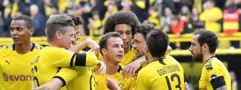 Dortmund's Mario Goetze, center, celebrates after scoring his side's third goal during the German Bundesliga soccer match between Borussia Dortmund and Fortuna Duesseldorf in Dortmund, Germany, Saturday, May 11, 2019. (AP Photo/Martin Meissner)