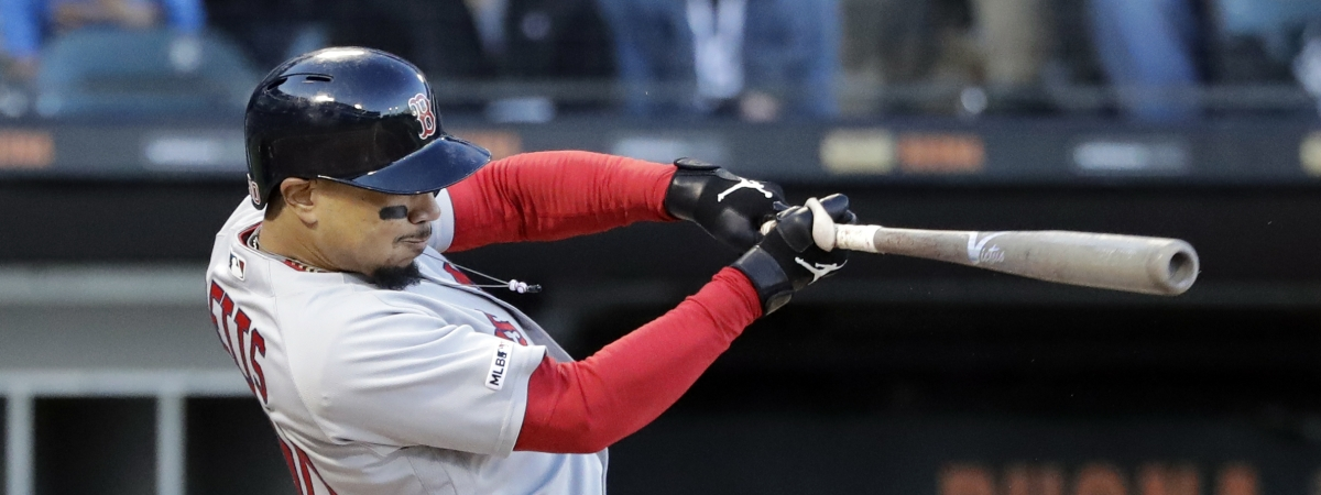 Boston Red Sox's Mookie Betts hits a two-run double against the Chicago White Sox during the third inning of a baseball game in Chicago, Saturday, May 4, 2019. (AP Photo/Nam Y. Huh)