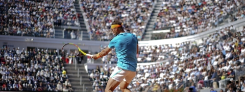 Rafael Nadal of Spain returns the ball to Fernando Verdasco of Spain during their quarterfinal match at the Italian Open tennis tournament, in Rome, Friday, May 17, 2019. (AP Photo/Andrew Medichini)