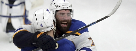 St. Louis Blues' Carl Gunnarsson (4), of Sweden, is congratulated by Pat Maroon, rear, after he scored the winning goal against the Boston Bruins during the first overtime period in Game 2 of the NHL hockey Stanley Cup Final, Wednesday, May 29, 2019, in Boston. (Bruce Bennett/Pool via AP)