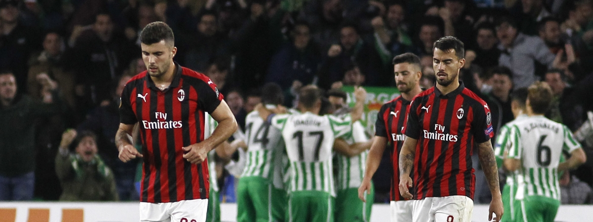 FILE - In this Nov. 8, 2018 file photo, Milan players react as Betis players, at the background, celebrate scoring their side's first goal, during the Europa League, Group F soccer match between AC Milan and Betis, at the Benito Villamarin Stadium in Seville, Spain. AC Milan's decision Friday, June 28, 2019 to voluntarily remove itself from next season's Europa League to pay for UEFA financial fair play breaches has received the consent of the Court of Arbitration for Sport. (AP Photo/Manuel Gomez, file)