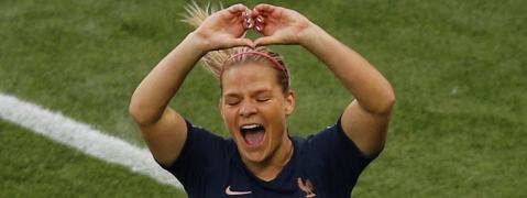 France's Eugenie Le Sommer celebrates after scoring the first goal of the Women's World Cup on June 7 (Francois Mori)