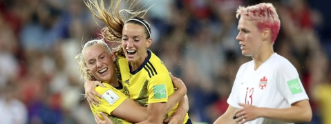 Sweden's Stina Blackstenius, left, celebrates after scoring the opening goal during the Women's World Cup round of 16 soccer match between Canada and Sweden at Parc des Princes in Paris, France, Monday, June 24, 2019. (AP Photo/Francisco Seco)