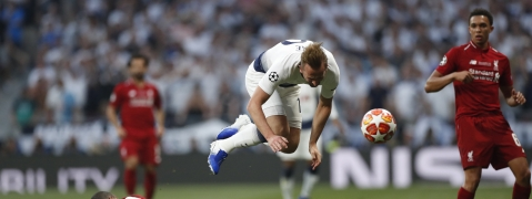 England's Harry Kane (playing for Tottenham) falls over Liverpool's Joel Matip during the Champions League final soccer match on June 1 (Bernat Armangue)