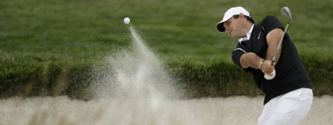 Patrick Reed hits out of the bunker on the sixth hole during the second round of the U.S. Open on June 14 (Marcio Jose Sanchez)