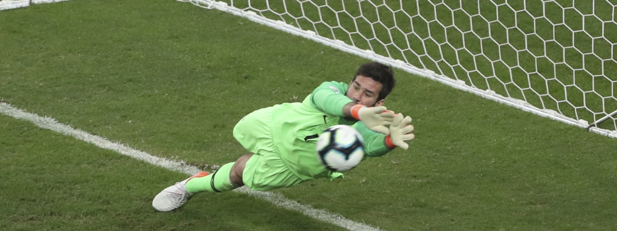 Brazil's goalkeeper Alison blocks the penalty kick by Paraguay's Gustavo Gomez during a Copa America quarterfinal soccer match at Arena do Gremio in Porto Alegre, Brazil, Thursday, June 27, 2019. (AP Photo/Ricardo Mazalan)