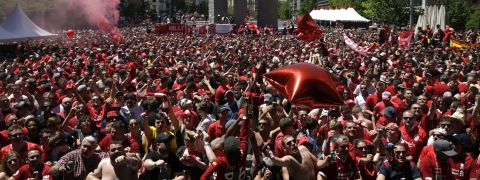 Liverpool supporters gather in a fan zone in downtown Madrid ahead of the Champions League final soccer match between Tottenham Hotspur and Liverpool at the Wanda Metropolitano Stadium in Madrid, Saturday, June 1, 2019. (AP Photo/Andrea Comas)