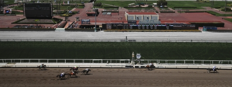 Horses finish the fourth race during the last day of the winter/spring meet at the Santa Anita horse racing track Sunday, June 23, 2019, in Santa Anita, Calif. (AP Photo/Chris Carlson)