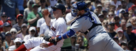 Red Sox's Brock Holt (left) is tagged out by  Blue Jays' Danny Jansen in the  second inning on June 23 (Steven Senne)