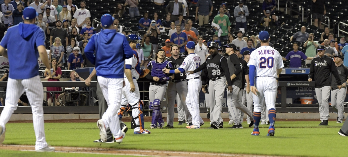 The Mets and Rockies get together to chat during their game on June 7 (Bill Kostroun)