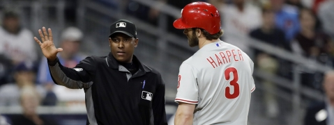 Phillies' Bryce Harper discusses his eighth-inning strikeout with umpire Ramon De Jesus on June 3 (Gregory Bull)