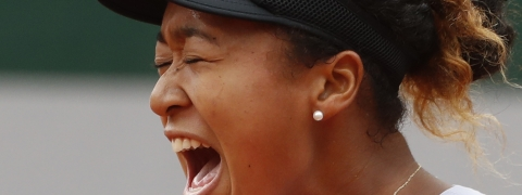 Japan's Naomi Osaka screams after scoring a point against Victoria Azarenka of Belarus during their second round match of the French Open tennis tournament at the Roland Garros stadium in Paris, Thursday, May 30, 2019. (AP Photo/Jean-Francois Badias)