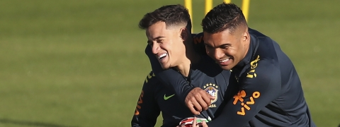 Phlippe Coutinho, left, is embraced by Casemiro during a training session of Brazil national soccer team in Porto Alegre, Brazil, Wednesday, June 26, 2019. Brazil will play against Paraguay for a Copa America quarter-final match on June 27.