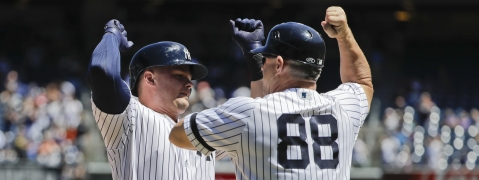 Yankees' Luke Voit (left) celebrates with third base coach Phil Nevin  after hitting a three-run home run in fourth inning of Game 1 on June 11 (Photo/Frank Franklin II)