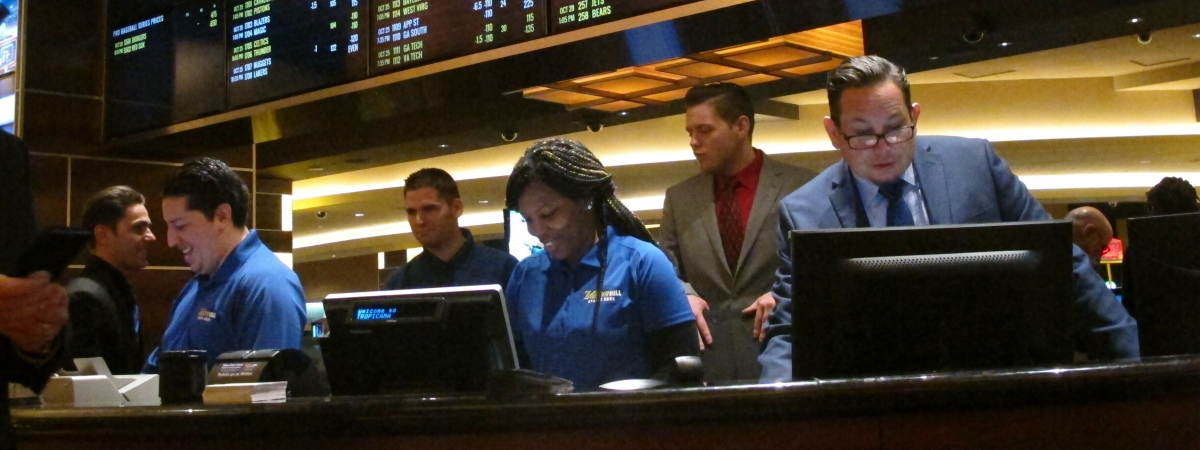 This Oct. 25, 2018 photo shows employees at the new sports book at the Tropicana casino in Atlantic City N.J., preparing to take bets moments before it opened.