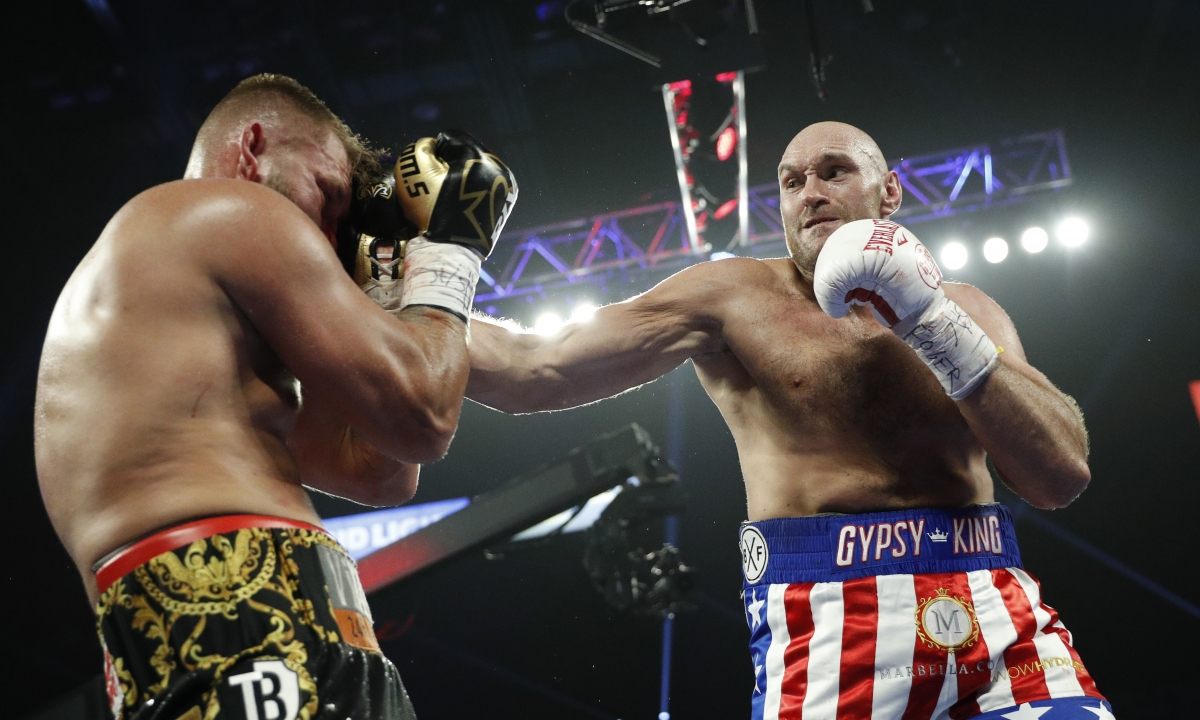 Tyson Fury stays unbeaten, stops Tom Schwarz before the bell ends Round 2 in heavyweight bout in Las Vegas