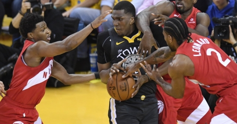 Warriors' Kevon Looney is defended  by  Raptors'  Kyle Lowry (left) and Kawhi Leonard  during Game 6 on  June 13 (Frank Gunn/The Canadian Press)
