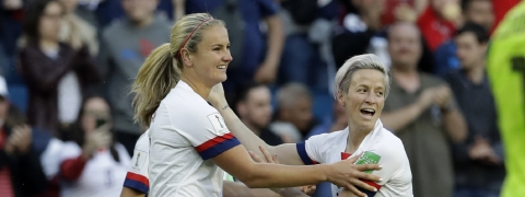 United States' Lindsey Horan, left, is congratulated by teammate Megan Rapinoe, right, after scoring her team's first goal during the Women's World Cup Group F soccer match between Sweden and the United States at Stade Océane, in Le Havre, France, Thursday, June 20, 2019. (AP Photo/Alessandra Tarantino)