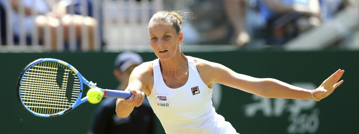 Czech Republic's Karolina Pliskova returns the ball to Kiki Bertens, of the Netherlands, on day six of the Nature Valley International tennis tournament at Devonshire Park, Eastbourne, England, Friday June 28, 2019. (Gareth Fuller/PA via AP)