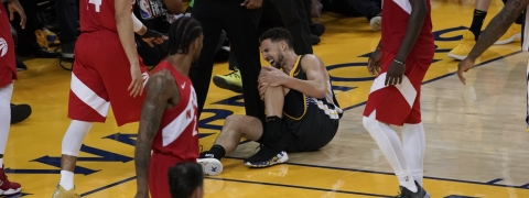 Golden State Warriors guard Klay Thompson reacts after being injured during the second half of Game 6 of basketball's NBA Finals against the Toronto Raptors in Oakland, Calif., Thursday, June 13, 2019. (AP Photo/Tony Avelar)