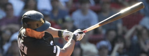 White Sox's Jose Abreu hits a two-run homer in the ninth inning against the  Red Sox on  June 26  (Elise Amendola)