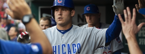 Chicago Cubs' Anthony Rizzo is congratulated by teammates after hitting a home run during the first inning of a baseball game against the St. Louis Cardinals on June 1, 2019.