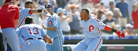 Phillies' Jean Segura (right) is greeted at home plate after hitting a walk-off three-run home run on June 27 (Matt Slocum)