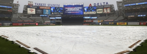 Yankee Stadium field is covered by a tarp as rain falls before June 10 game is postponed (Kathy Willens)