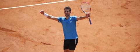 Austria's Dominic Thiem celebrates winning his semifinal match of the French Open tennis tournament against Serbia's Novak Djokovic in five sets, 6-2, 3-6, 7-5, 5-7, 7-5, at the Roland Garros stadium in Paris, Saturday, June 8, 2019. (AP Photo/Christophe Ena)