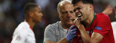 Portugal's Pepe, right, grimaces in pain after a tackle by Switzerland's Manuel Akanji during the UEFA Nations League semifinal soccer match between Portugal and Switzerland at the Dragao stadium in Porto, Portugal, Wednesday, June 5, 2019. (AP Photo/Armando Franca)