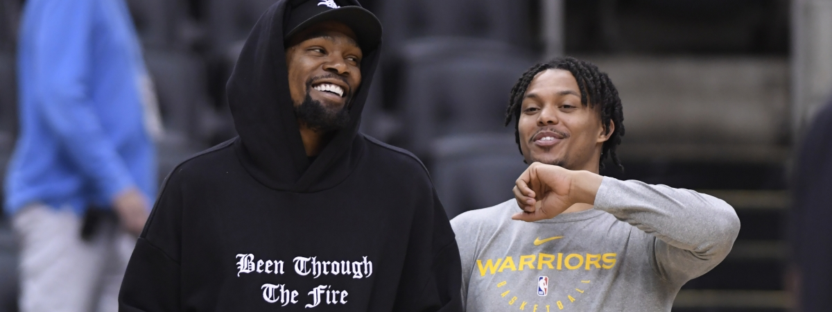 Golden State Warriors Kevin Durant, left, laughs with teammate Damion Lee during basketball practice at the NBA Finals in Toronto, Saturday, June 1, 2019. (Nathan Denette/The Canadian Press via AP)