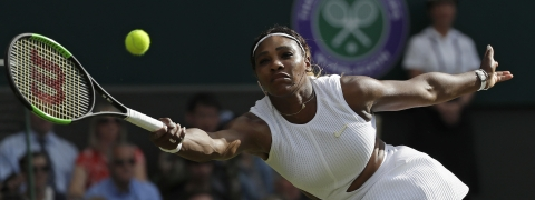 United States' Serena Williams returns to Italy's Giulia Gatto-Monticone in a Women's singles match during day two of the Wimbledon Tennis Championships in London, Tuesday, July 2, 2019. (AP Photo/Ben Curtis)