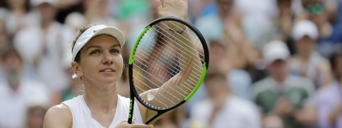 Romania's Simona Halep celebrates after beating Belarus' Victoria Azarenka in a Women's singles match during day five of the Wimbledon Tennis Championships in London, Friday, July 5, 2019. (AP Photo/Ben Curtis)