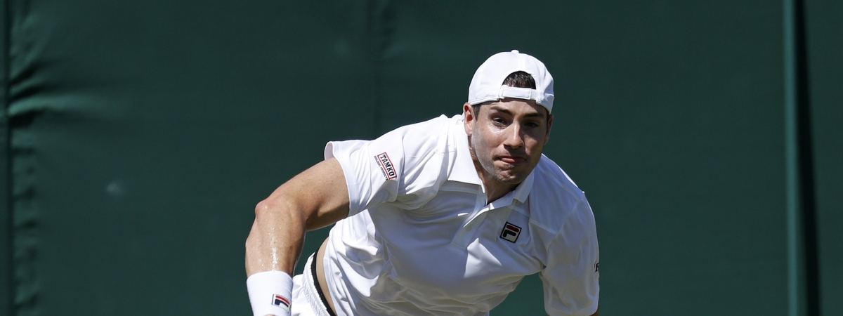 United States John Isner serves to Kazakhstan's Mikhail Kukushkin in a Men's singles match during day four of the Wimbledon Tennis Championships in London, Thursday, July 4, 2019. (AP Photo/Alastair Grant)