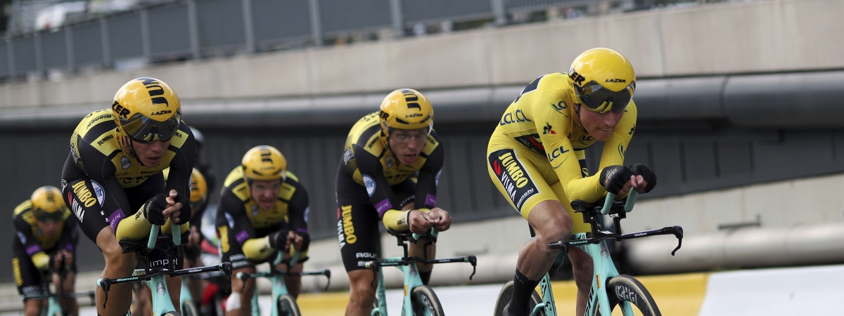 Team Jumbo-Visma strains during the second stage of the Tour de France cycling race, a team time trial over 27.6 kilometers (17 miles) with start and finish in Brussels, Belgium, Sunday, July 7, 2019.