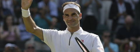 Switzerland's Roger Federer celebrates after beating Britain's Jay Clarke in a Men's singles match during day four of the Wimbledon Tennis Championships in London, Thursday, July 4, 2019.
