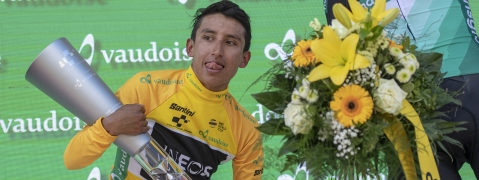 FILE - In this June 23, 2019 file photo, Egan Bernal from Colombia of Team Ineos lifts the trophy after winning the Tour de Suisse at the ninth and final stage. He's one of the top contenders at cycling's Tour de France which starts this weekend from Belgium. (Urs Flueeler/Keystone via AP, File)