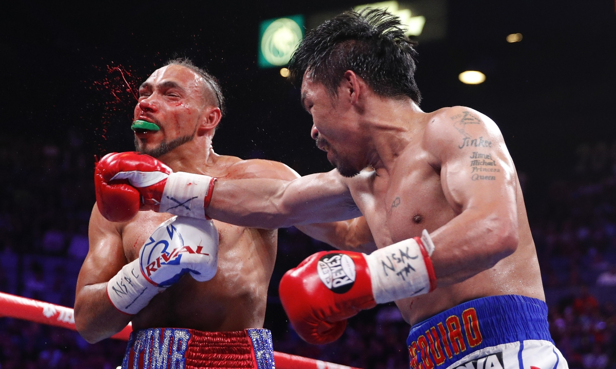 Manny Pacquiao defeats Keith Thurman by split decision after 12 rounds of great welterweight action in Las Vegas; Pacquiao claims WBA title