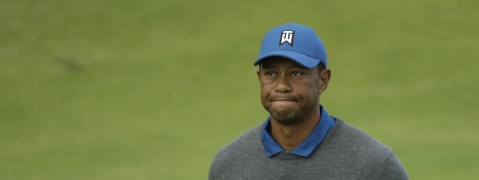 Tiger Woods of the United States looks up as he walks off the 18th green after completing his first round of the British Open Golf Championships at Royal Portrush in Northern Ireland, Thursday, July 18, 2019. (AP Photo/Matt Dunham)