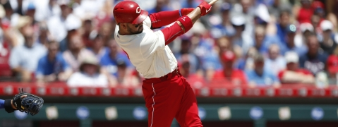 Reds' Eugenio Suarez hits a three-run home run off Cubs starter Jon Lester on June 30 (Gary Landers)