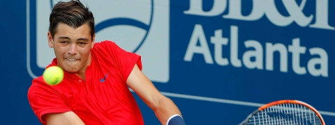 Taylor Fritz battles Feliciano Lopez in the first round of the U.S. Open.